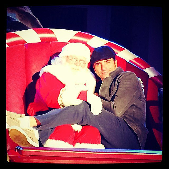 "John Stamos got up close and personal with Santa in this snap, which he cleverly captioned, ""This guy sleighs me."" Source: Instagram user johnstamos"