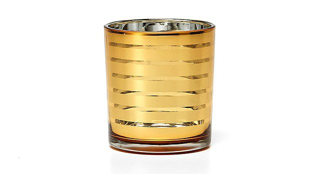 Without looking at the price tag, there's no way you'd know this gold striped votive holder ($8) from C. Wonder rings in at under $10. Très chic!