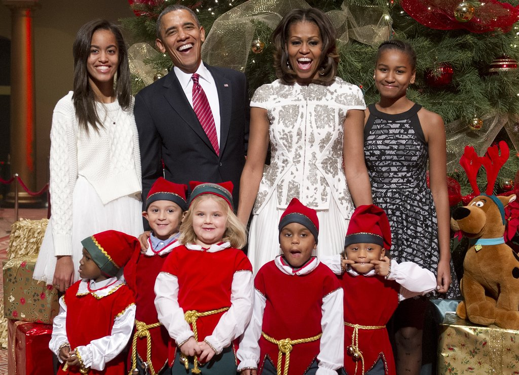 President Barack Obama and First Lady Michelle Obama had a laugh with their family while hanging out with children dressed up as elves during a taping of TNT's Christmas in Washington special on Sunday.