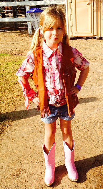 Stella loved dressing in the cowgirl theme! Complete with pink cowboy boots, of course.