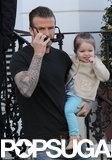 David looked every bit the cool dad while holding onto Harper in London back in April.