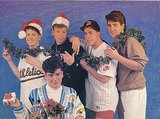 FYI, New Kids on the Block Wore Santa Hats and Garland With Their Normal Clothes