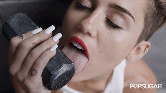 """When the music video for """"Wrecking Ball"""" came out in September, Miley's tongue was the main attraction, costarring with a very lucky sledgehammer."""