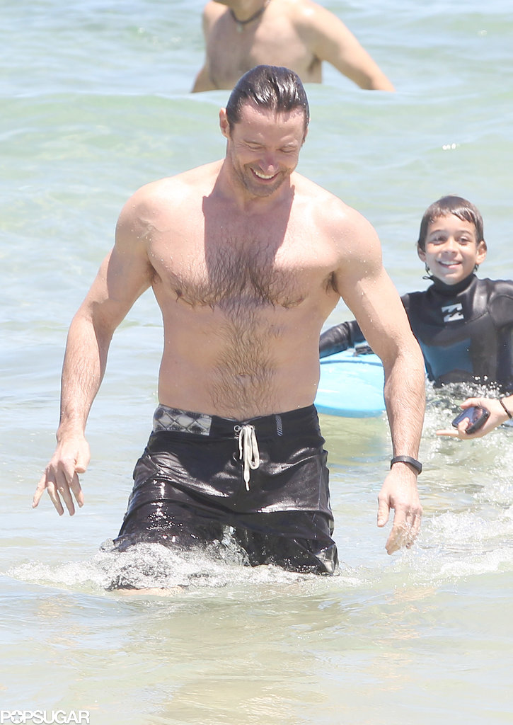 Hugh Jackman smiled shirtless in the water at Bondi Beach.