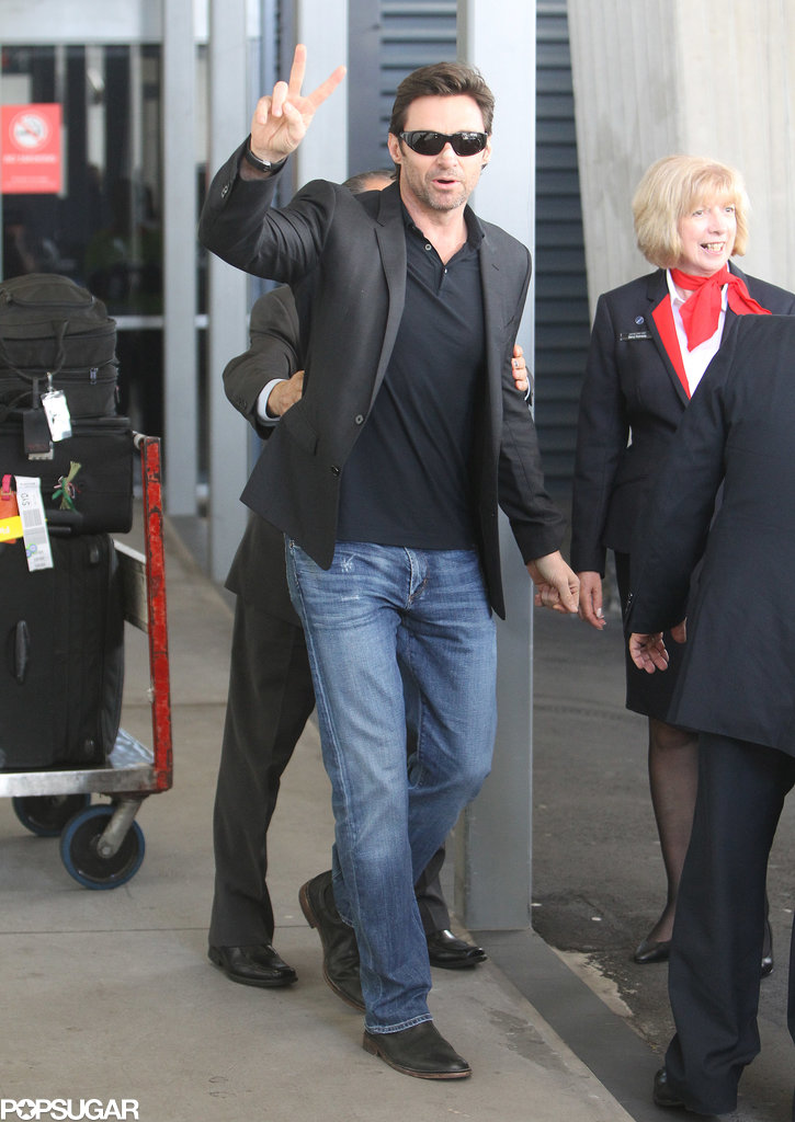 Hugh Jackman flashed a peace sign to fans in Sydney.