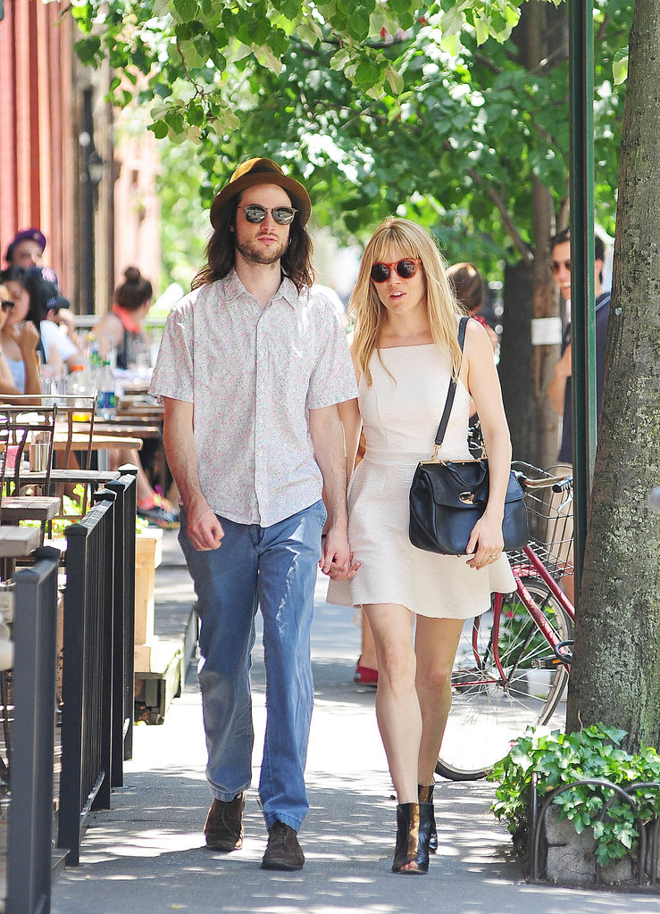 She wore a creamy fit and flare and patent peep-toe booties while strolling around NYC with Tom Sturridge in May 2013.