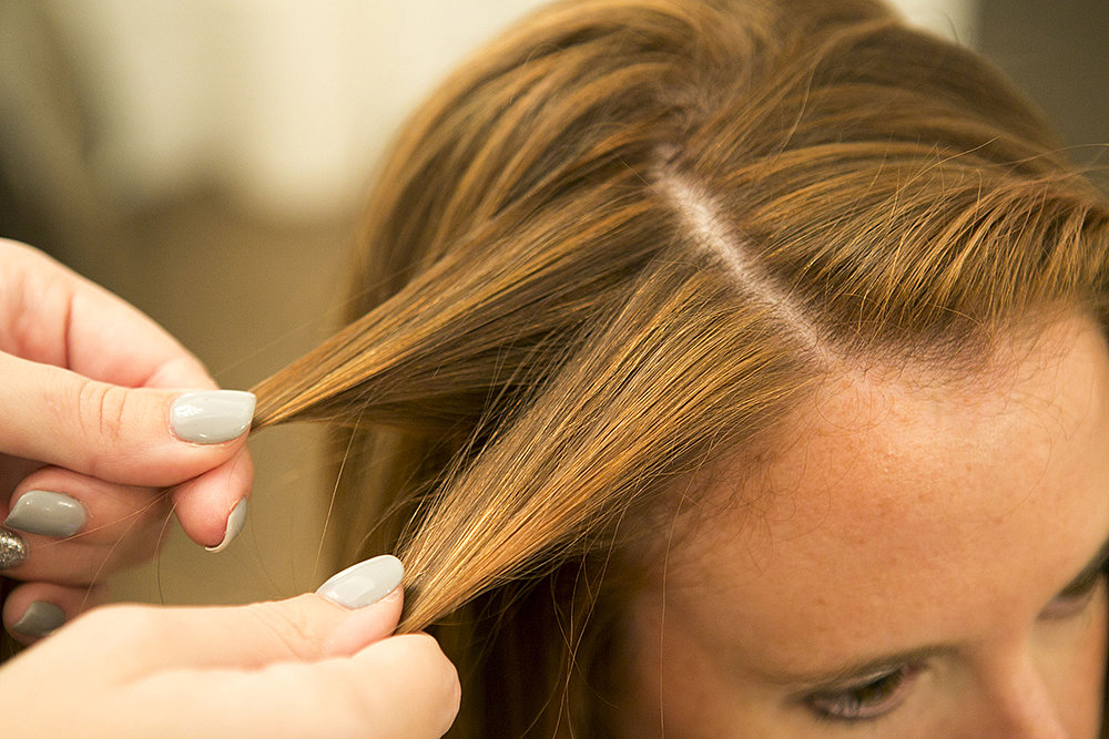 To start your waterfall twist, take two sections of hair. Source: Caroline Voagen Nelson