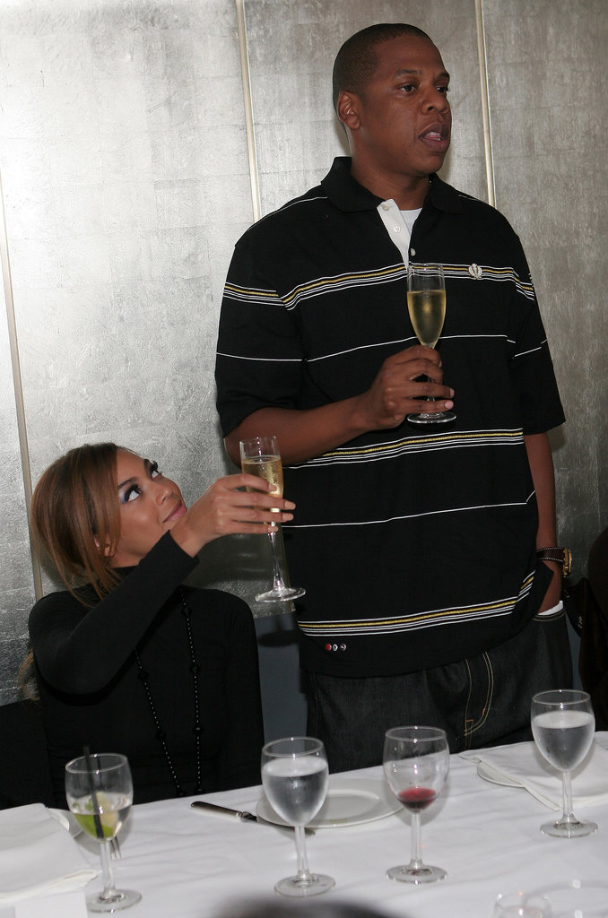 During a celebratory NYC dinner in May 2006, Jay Z proposed a toast, while Beyoncé Knowles raised her glass.