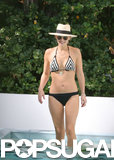 Molly Sims flaunted her figure in a bikini in Miami Beach, FL.