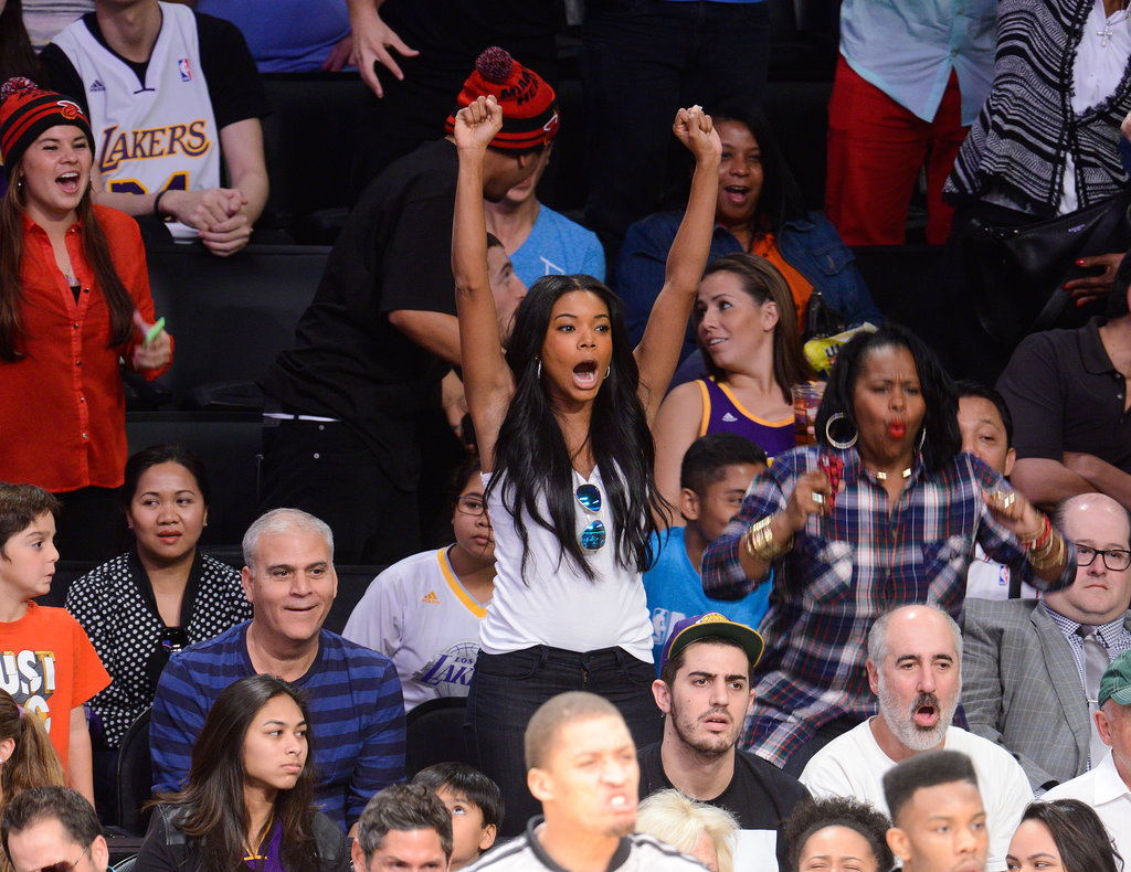 Gabrielle stood in the stands to support the Heat.