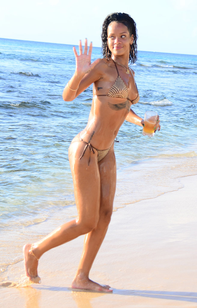 Rihanna relaxed on the beach in Barbados with a beverage in December 2013.