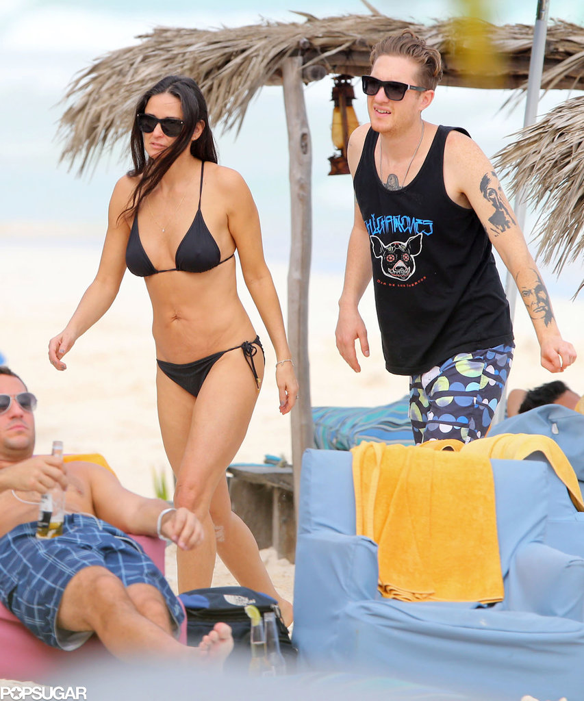 Demi and her guy walked in the sand.