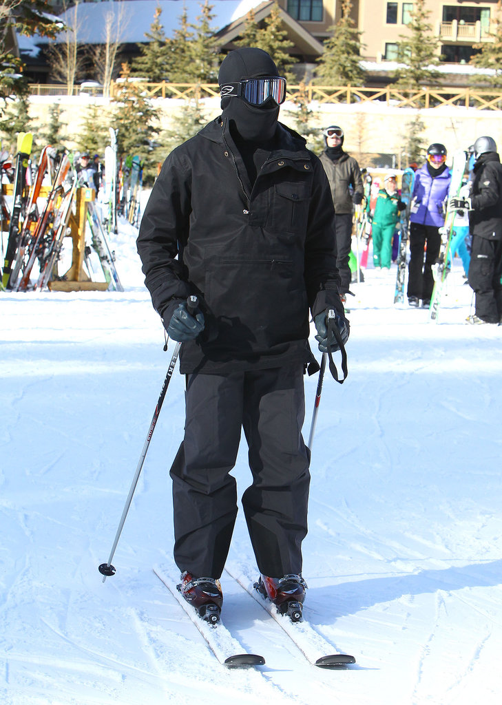 Kanye West was all covered up during the group's ski trip.