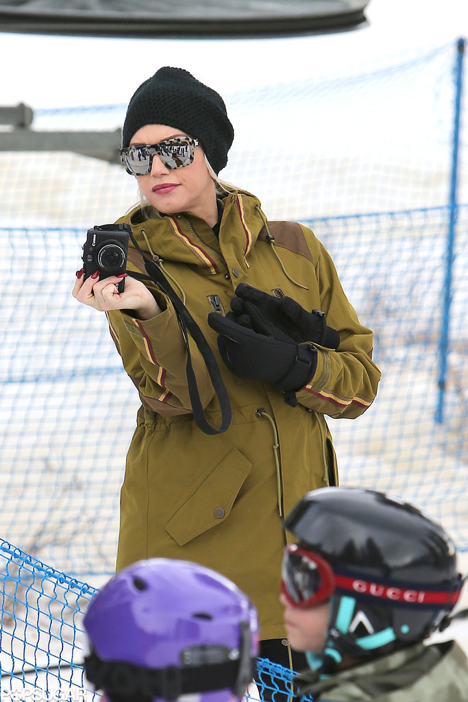 Gwen took photos of her son during his skiing class.