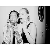 The two posed for a photo with some Champagne. 