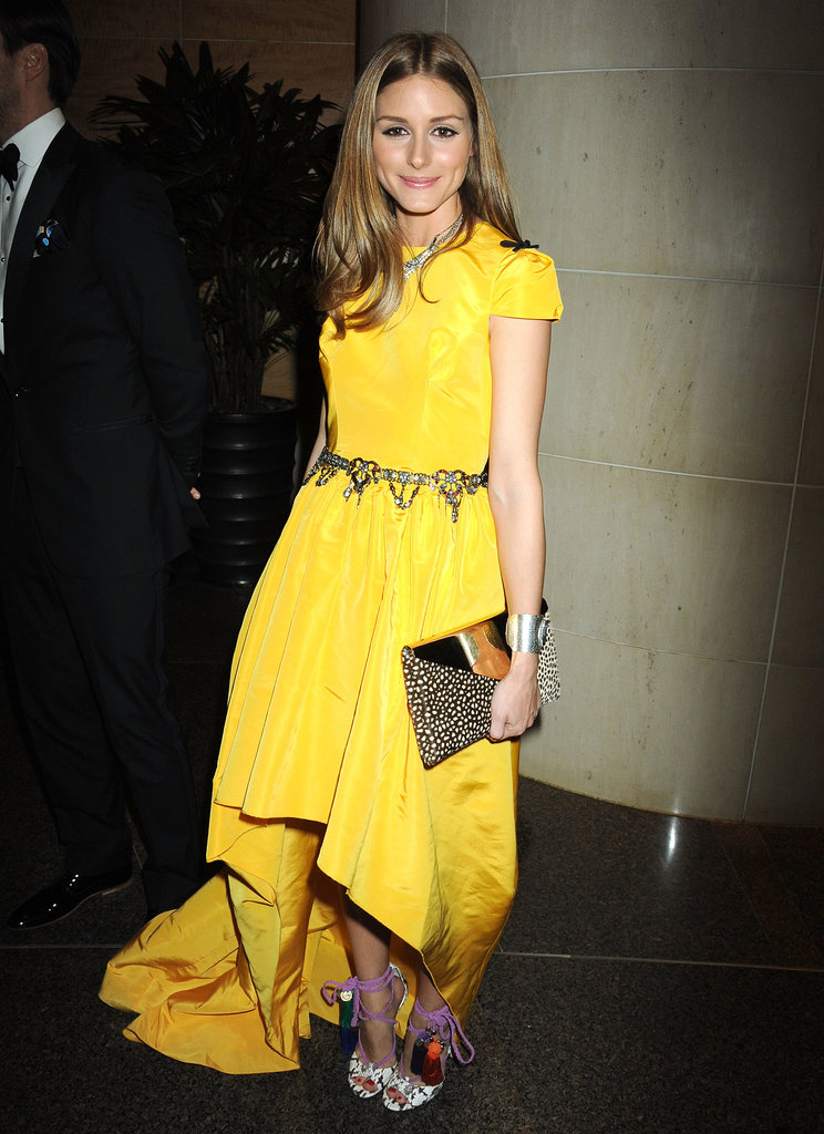 Though we're nearly certain we won't see Olivia in any color outside of the ivory family, there are potential clues in the shape of the daffodil-yellow Katie Ermilio gown she picked for a New York City event.