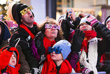 People sported 2014 glasses while they waited for the ball to drop in NYC.
