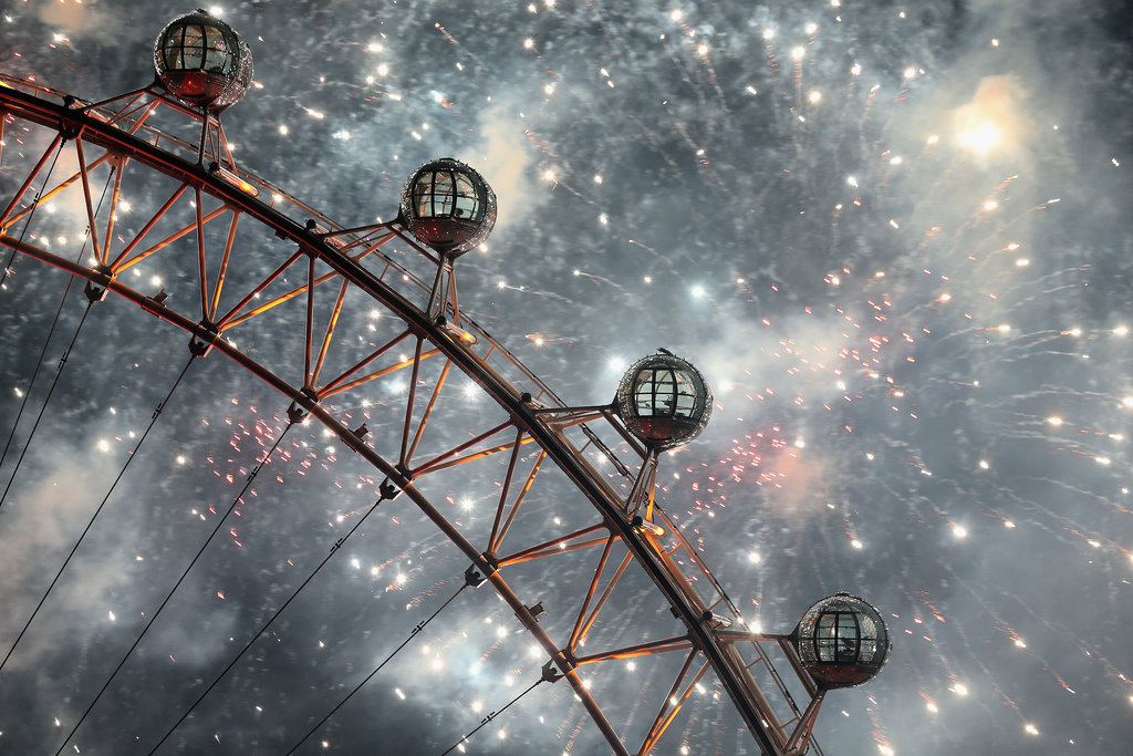Fireworks filled the sky beside the London Eye in England.