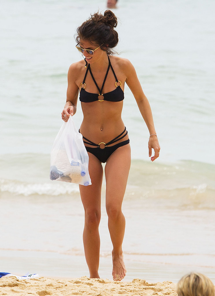 AnnaLynne walked on the sand.