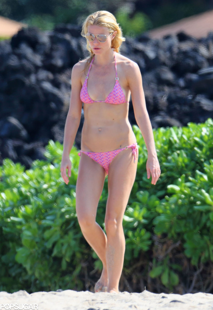 Gwyneth walked across the beach.