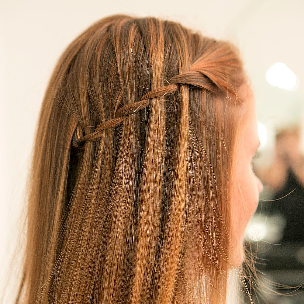 What the heck is a waterfall braid you ask? It's only the chicest way to get a half-up hairstyle. Learn how to re-create this style yourself.  Source: Caroline Voagen Nelson