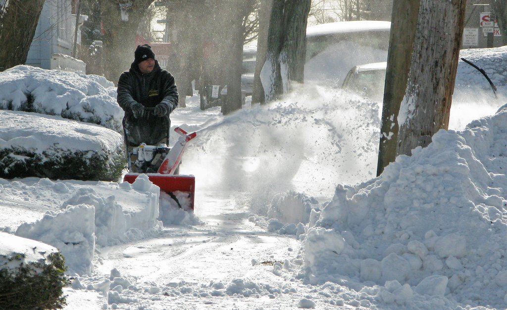 In the Bronx, a man cleared the sidewalk, leaving giant piles of snow in his wake.