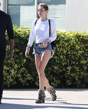 And how do you travel if you're Miley Cyrus? The crop-top-loving star picked super (super!) short cutoffs, a white top, and snow-leopard-print booties when she landed in Miami this Winter.