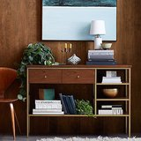 The Nook Console's ($499) midcentury-minimalist frame gets a dose of glam thanks to its brass detailing.