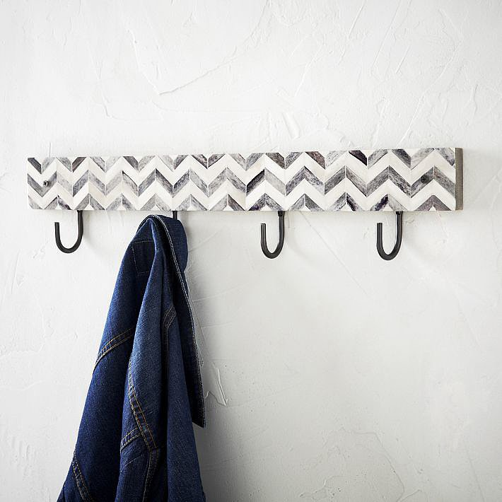 Finally — a rack that will give your designer coats some competition. This chevron-patterned Parsons Hook ($49) is the key to a cute entryway.
