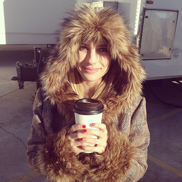 Emma Roberts bundled up with hot coffee on the set of American Horror Story: Coven. Source: Instagram user emmaroberts6