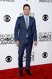 Arrow star Stephen Amell suited up in blue.