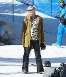 For a day on the slopes with her family, Gwen didn't just pick any old ski parka. She covered up her leopard sweater with a warm jacket in an unexpected hue: olive green.