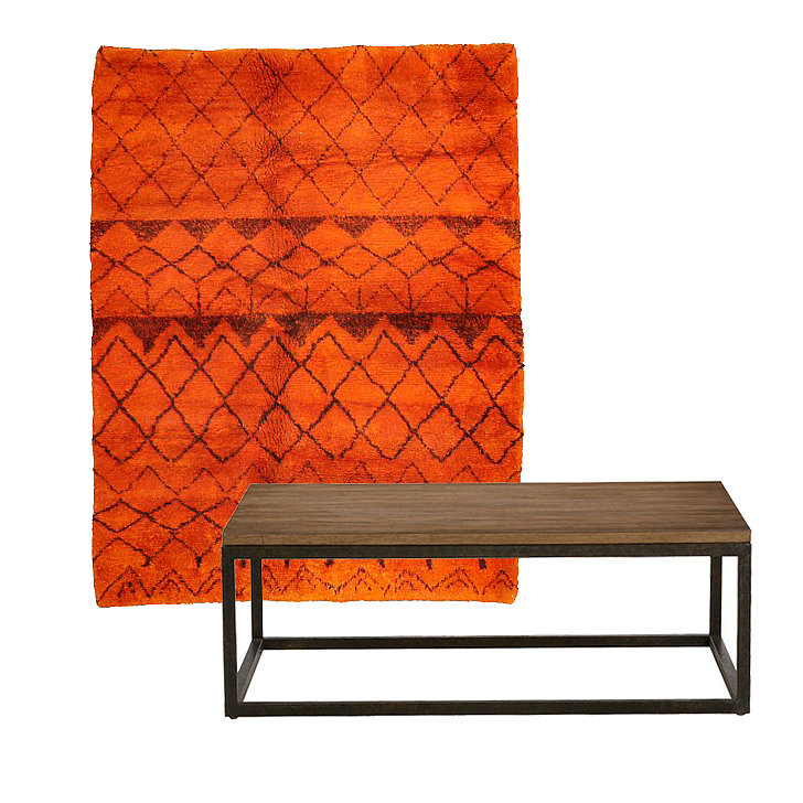 For a space that is casually styled, consider placing a vibrant orange rug ($1,402, originally $6,599) with a contemporary oak table ($639, originally $749). The rug's bohemian pattern is nicely offset by the table's modern lines.