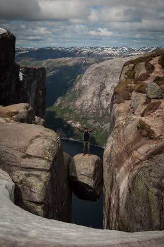 Stand on a Boulder Wedged Between Mountains