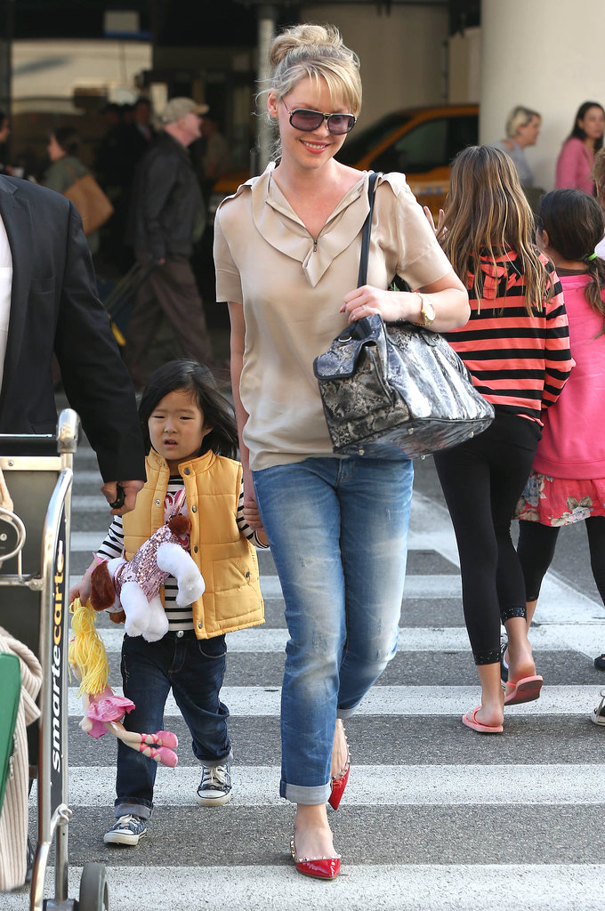 Katherine Heigl and her daughter Nancy held hands while arriving at LAX on Wednesday.