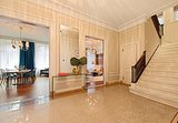The tiled floors give the foyer the feel of a grand hotel. Source: Douglas Elliman Real Estate