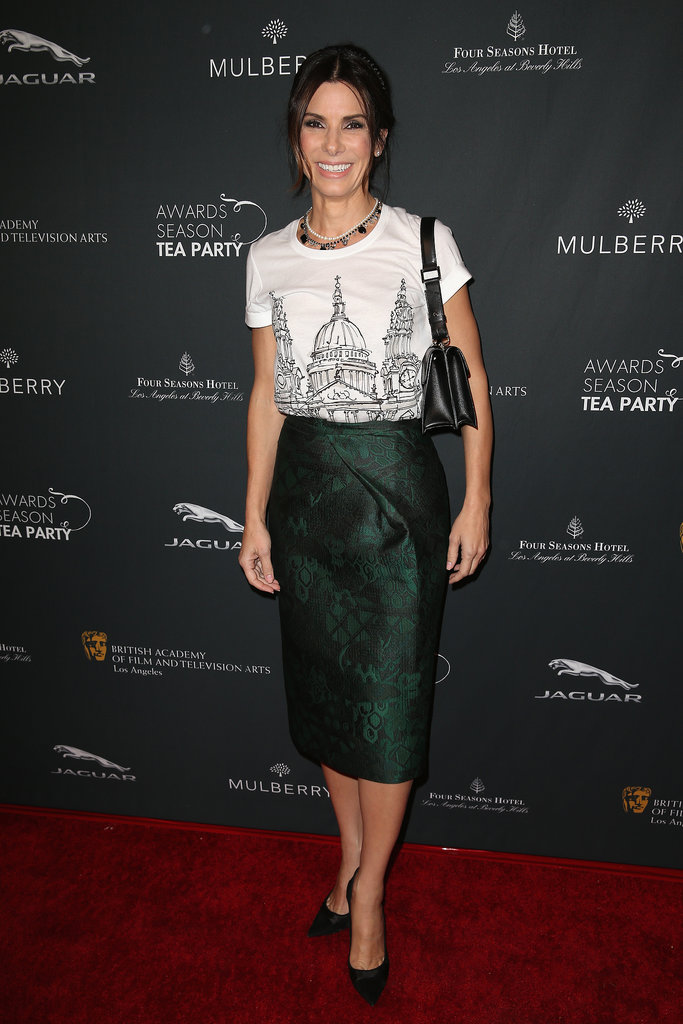 Sandra Bullock wore a green skirt.