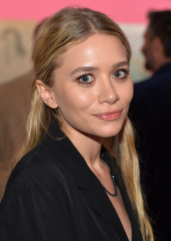 A rare appearance from Ashley Olsen saw her in her signature style: a boho updo, glossy lips, and a bronze smoky eye.