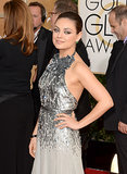 Mila Kunis wore a Gucci gown and Marina B jewelry.