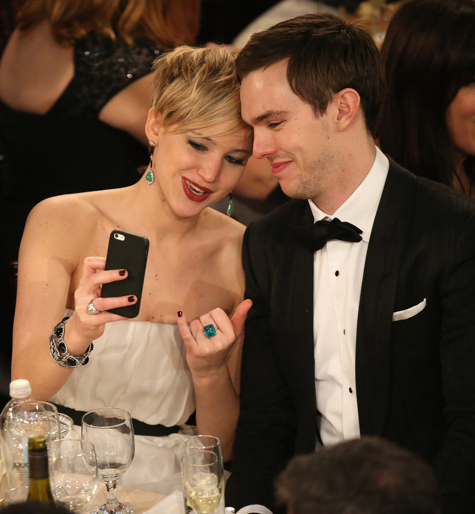 Jennifer Lawrence and Nicholas Hoult took a selfie at their table.  Source: Christopher Polk/NBC/NBCU Photo Bank/NBC