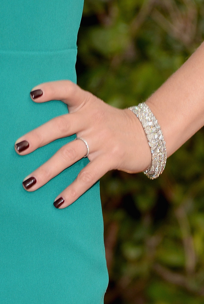 Reese Witherspoon added sparkle with $3.7 million worth of Harry Winston diamonds — including that 10-carat emerald-cut diamond ring and those three-stacked diamond line bracelets.