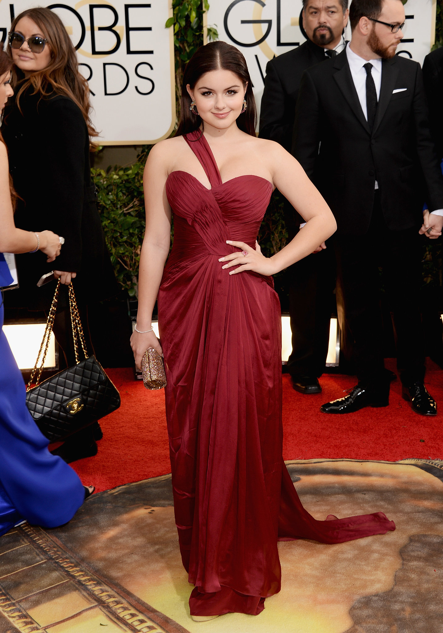 Ariel Winter paired a red Mikael D dress with Jimmy Choo shoes ...