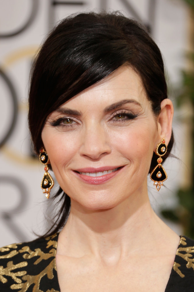 "Julianna Margulies echoed the black and gold of her gown with Van Cleef & Arpels ""1973"" earrings."