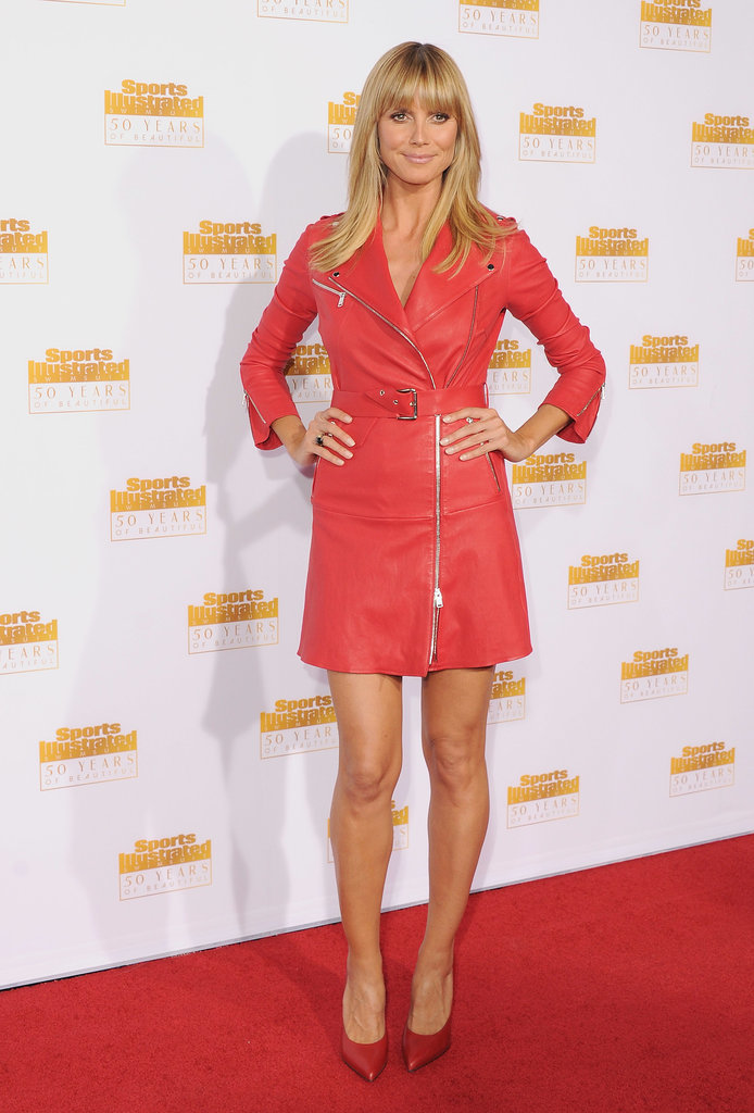 Heidi Klum wore a red coat on the carpet.