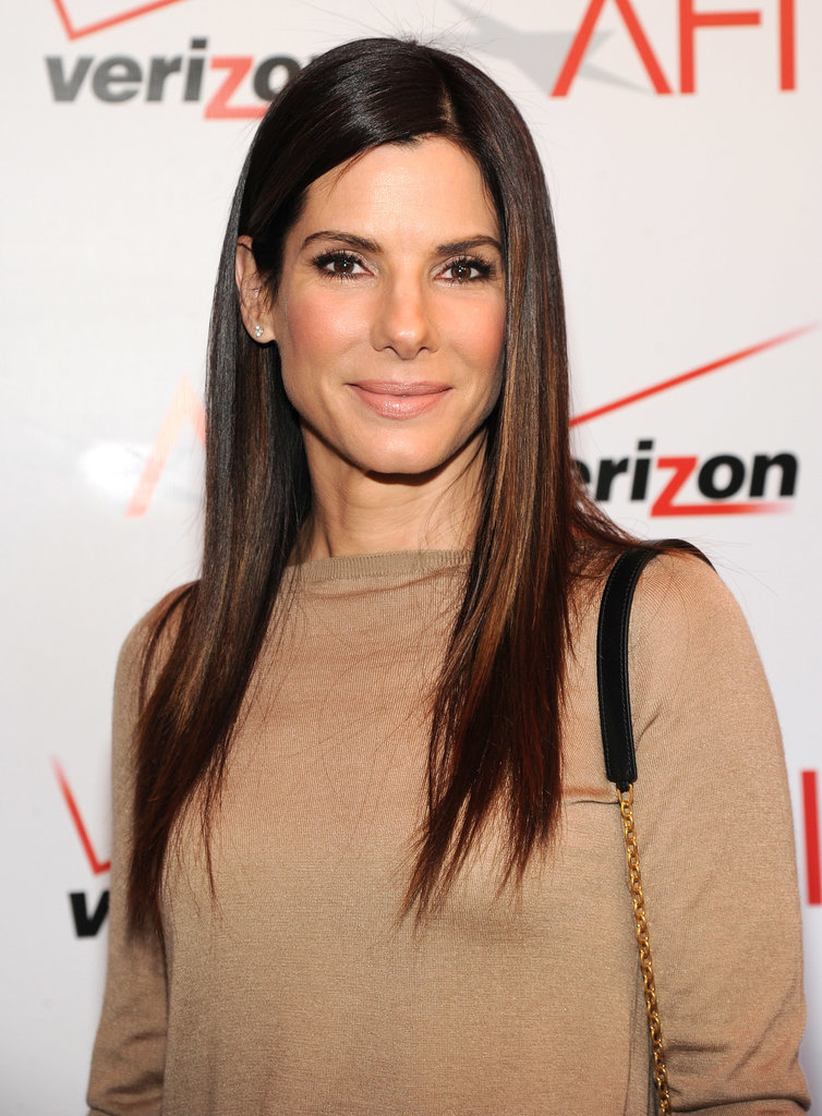 Sandra Bullock's shade, which marries deep umber tones with rich chestnut hues, is the perfect balance of nearly-jet-black and medium brown.