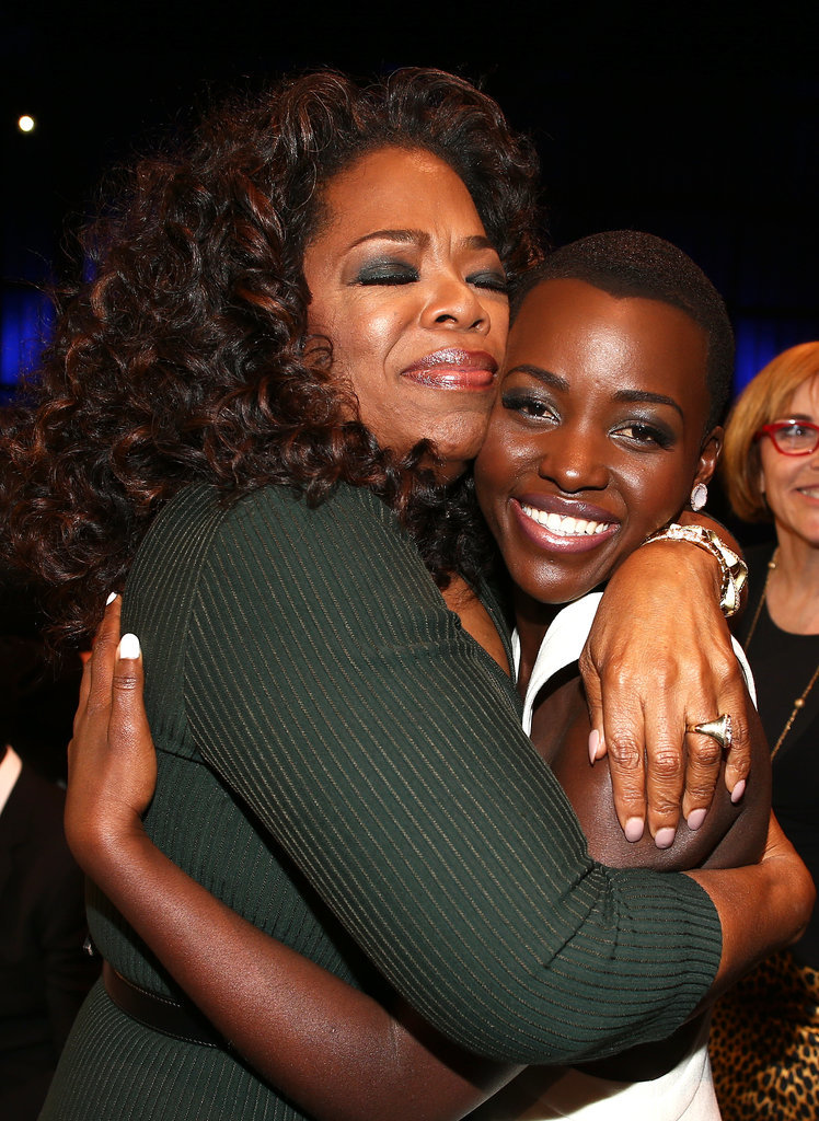 Oprah Winfrey covered Lupita Nyong'o with love at the Critics' Choice Awards in LA.