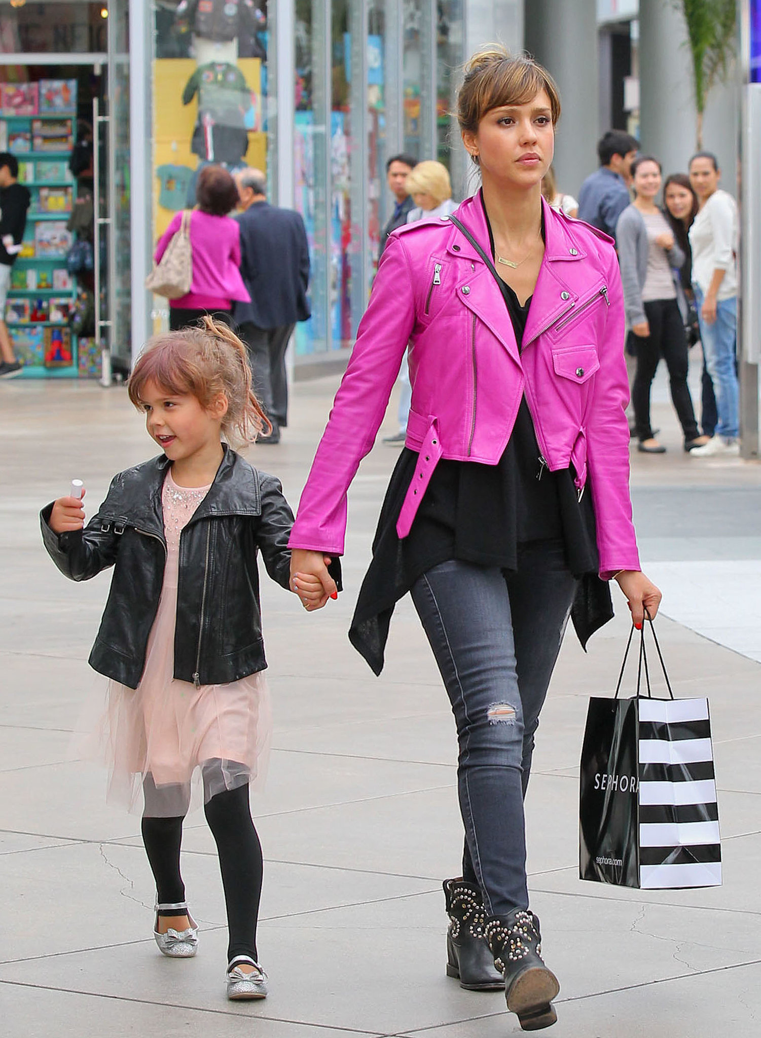 It was all about a hot-pink leather biker jacket and distressed 7 For All Mankind jeans for Jessica Alba while indulging