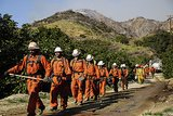 Firefighters walked through the foothills of Azusa, CA, while working to fight the blaze.