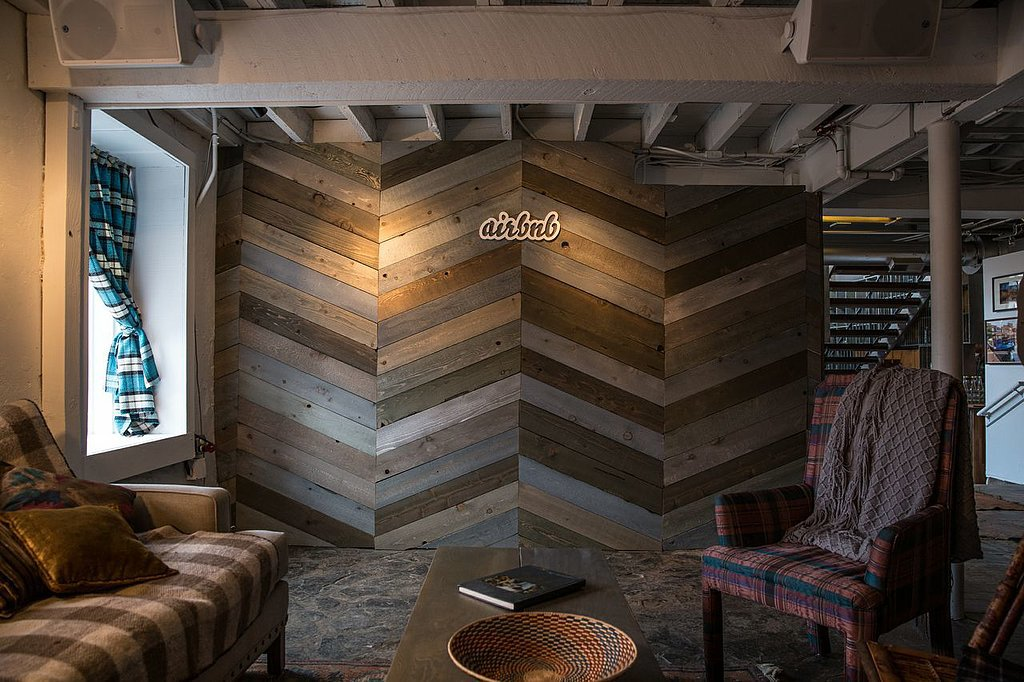 Now here's wood paneling we support. While still rustic, the chevron pattern makes for a very modern and trendy focal wall.  Photo by Michael Friberg via Airbnb