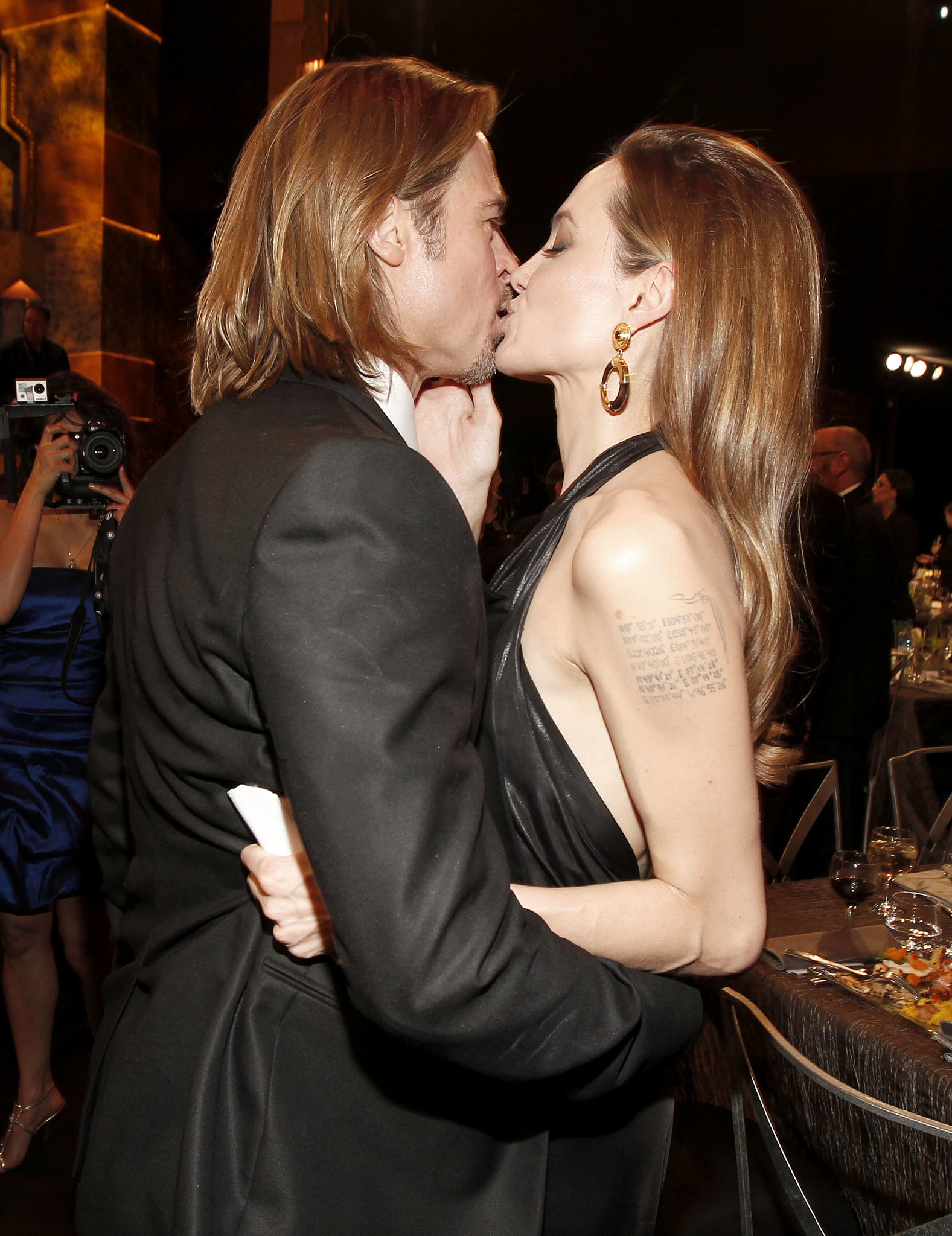 Brad Pitt and Angelina Jolie locked lips inside the 2012 SAG Awards.